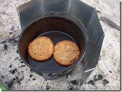 cooking veggie burgers outdoors