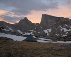 A tent set up in the Sunset at the base of East Temple peak.