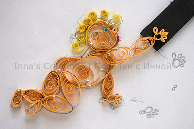 Crawling baby. Quilling
