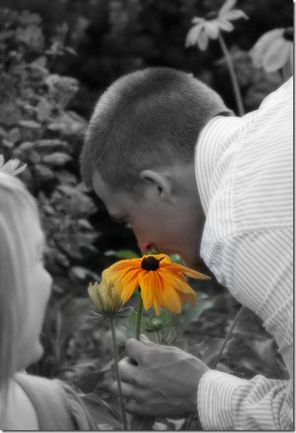 Greg sniffing flower
