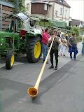 Traktorist und Alphornbläser