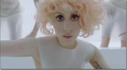 "In Lady Gaga's ""Bad Romance"" music video, there's a scene that shows her in"