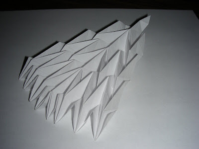 Collapsed diagonal v-shaped origami accordion bottom view