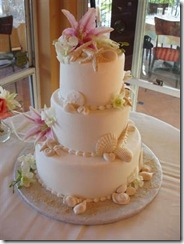 Tropical Wedding Cakes with Shells and Tropical Flower