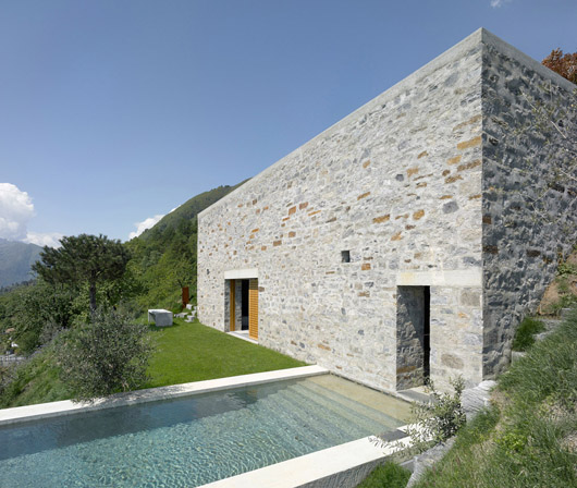 contemporary stone home exterior swimming pool