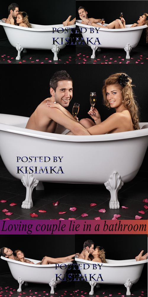 Stock Photo: Loving couple lie in a bathroom