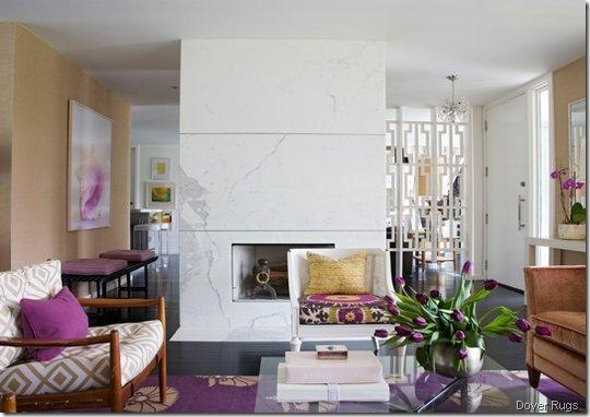 angie-hranowsky-living-room-marble-modern-fireplace-center-purple-accents-accessories-pillow-rug-white-geometric-screen dover rugs