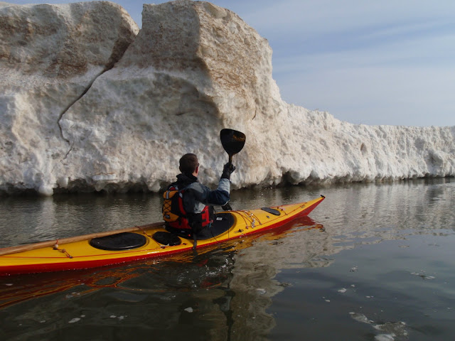 John Fleming Sea Kayaking past a crack in the cliff