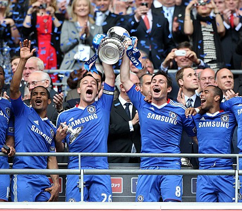 Chelsea's Didier Drogba, Florent Malouda, John Terry, Frank Lampard, Ashley Cole and Nicolas Anelka celebrate with the FA Cup after winning the FA Cup Final at Wembley Stadium, London