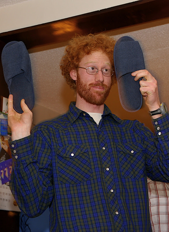 Anna's brother is now the proud owner of Doug's return-flight slippers!