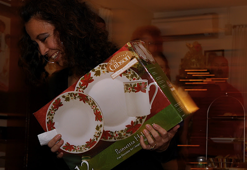 This coveted set of holiday plates is zipped across the room by an adult.