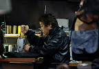 How many people you know work a sewing machine in a leather jacket?