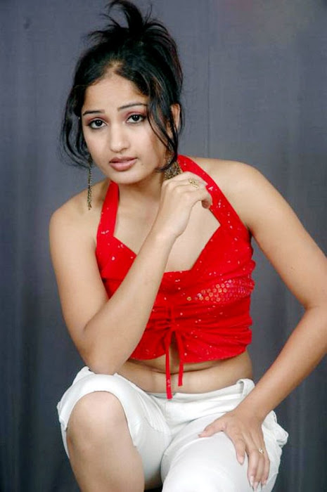 madhavi latha sizzles in redstights closeup views unseen pics
