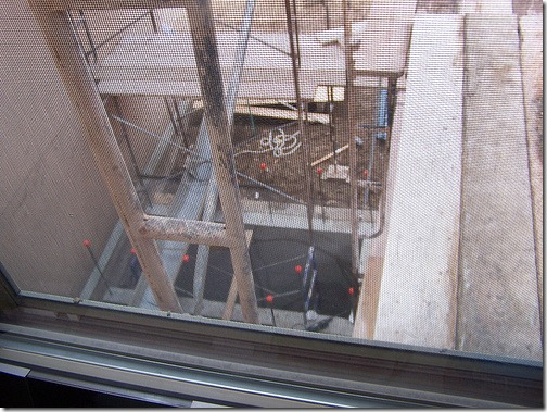 Scaffolding is outside my window again, this time to set forms for the elevator shaft