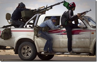 Libyan rebels retreat from the outskirts of the city of Ajdabiya, south of Benghazi. Nato members are also fighting over who will take command of allied forces