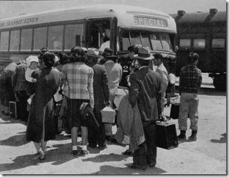 Buses taking Japanese-Americans to the War Relocation Centger at Manzanar