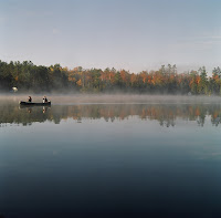 Time for a bit of Canadiana. This picture was taken early in the morning on Jack Lake, at a friend's cottage. Daryl and Janet are in the canoe, while I am safely ensconced on the pier taking pictures.<br /> Location: Jack Lake<br /> Camera: Mamiya C330 Dual Lens