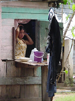 Date: 2003</p> <p>Location: Roatan Island, Honduras</p> <p>Story: Out for a walk. This beautiful woman is performing her morning constitutionals. I took two pictures of her. She is not looking at in the first. I am not sure who caught whom int he second instance.