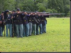 Re-enactors demonstrate firing from 2-line formation