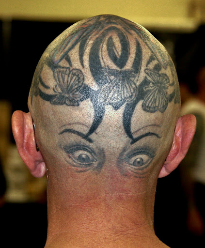 Weird tattoo design on back of head