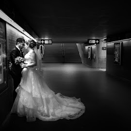 Railroad station by Frédéric Trin - Wedding Bride & Groom ( railroad station, wedding, dramatic, bw, france, bride and groom, long dress )