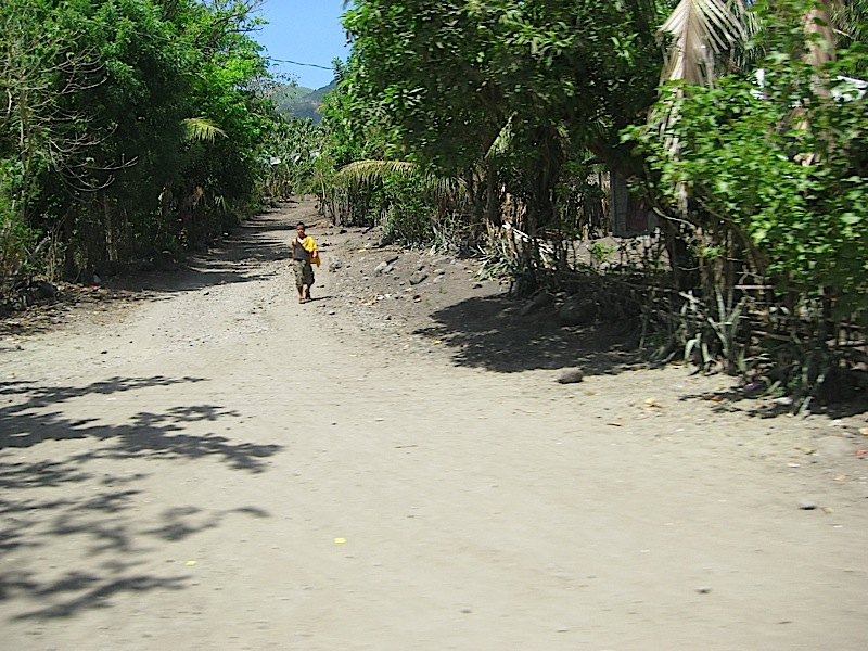 dirt road outside a town center in Marinduque province