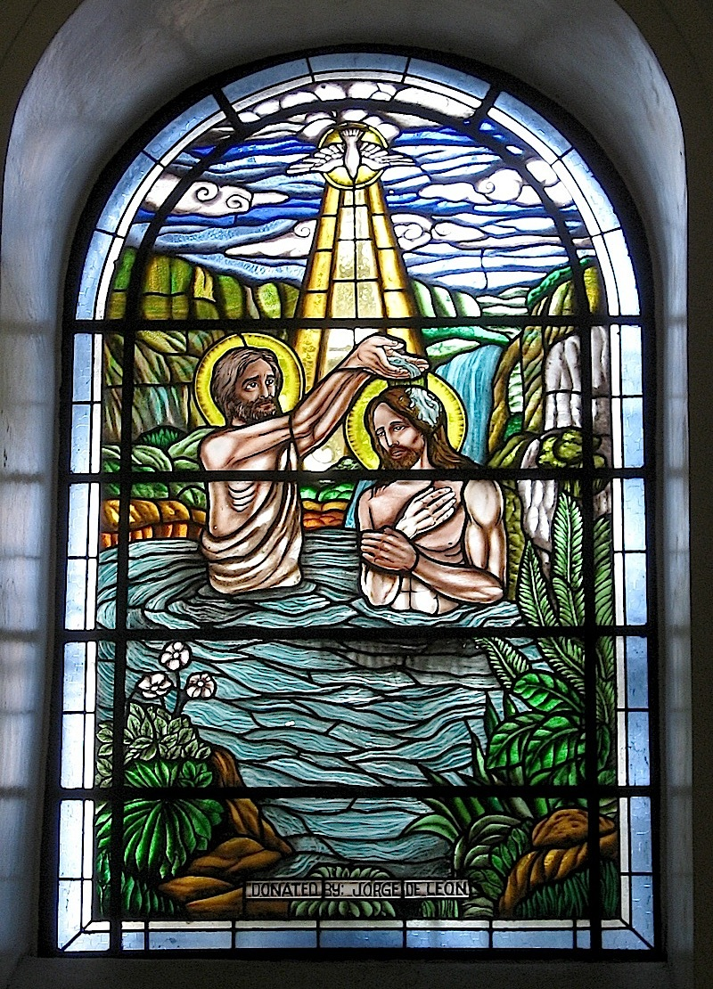 Malate Church stained glass window of Jesus' baptism