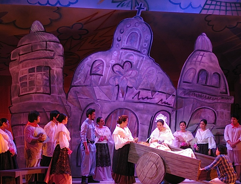 Ateneo de Manila University's production of Walang Sugat - Tenyong dying at the church