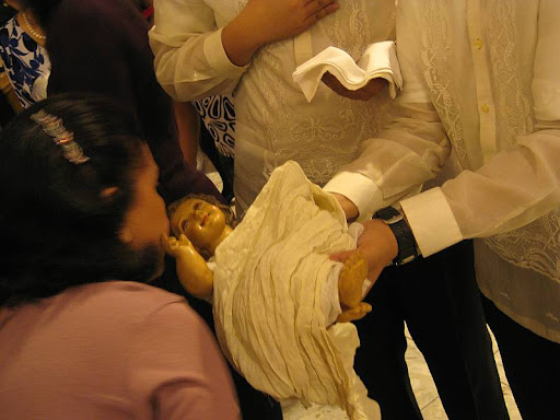 venerating the infant Jesus after the Christmas Eve Mass