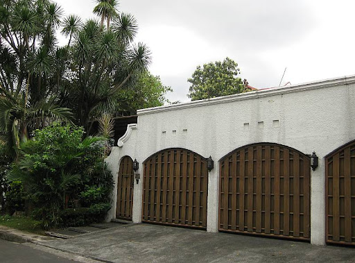 house with white walls and wooden gates