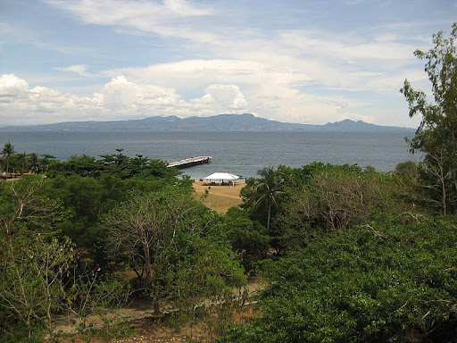 view of the South Dock, South Channel and the hills of Cavite from the dining room of Corregidor Inn