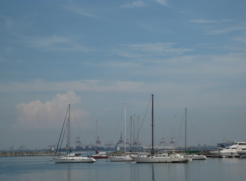 sailboats and gantry cranes in Manila Bay