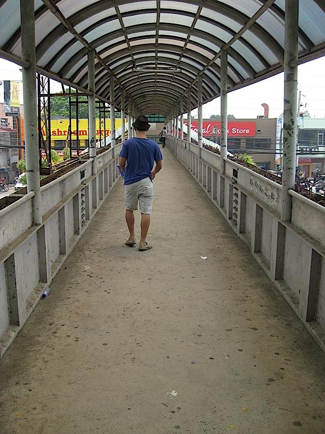 footbridge in front of Ateneo de Manila University crossing Katipunan Avenue