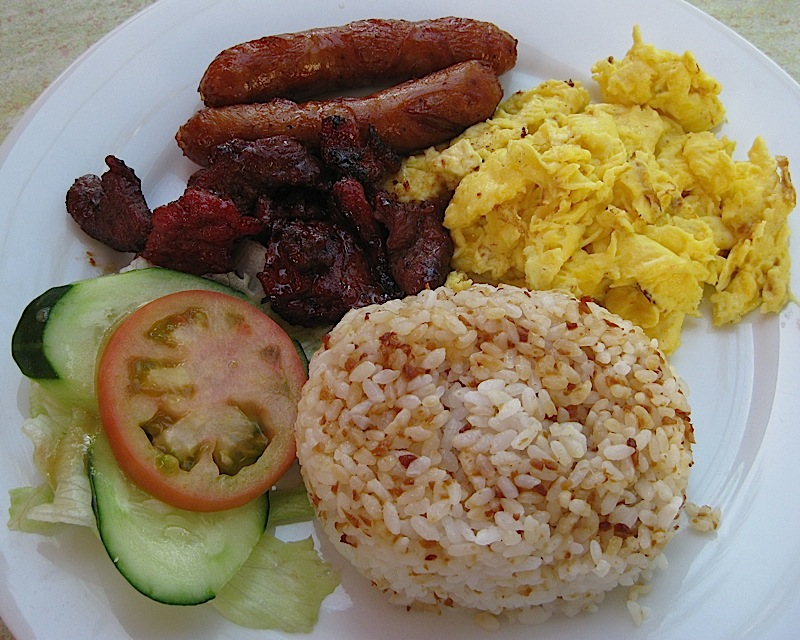 Filipino breakfast consisting of fried garlic rice, eggs, tapa, tocino and longganisa