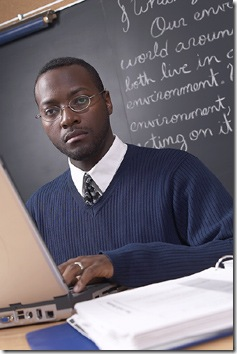 teacher_at_computer_and_blackboard