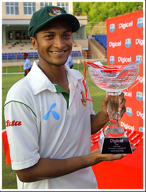 Shakib Al Hasan poses with the series trophy
