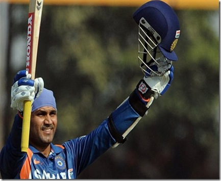 Virender Sehwag celebrates after reaching his century against Sri Lanka
