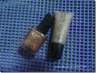 four east silver lip gloss and light gold nail polish