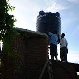 plaatsing van watertank op de watertoren