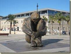 Crounching Man statue - huge
