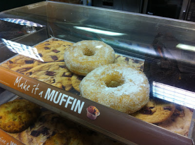 The photo shows and obvious doughnut in a container labled muffins