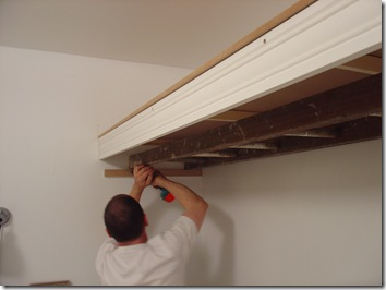 Install the ladder/clothes rail