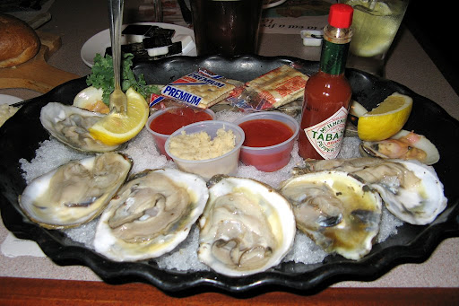 with a shellfish platter of 6 icy clams and 6 oysters on the half shell.