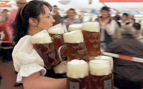 Beer Mug World Record...Anita Schwarz from Eichenau tries to set a new world record carrying 21 beer mugs at once across a distance of 40 metres in a tent near Zeltingen, Germany, 09 November 2008. However, Eichenau fails to transport the mugs in one piece. Ref: B284_123995_0002 Date: 09.11.2008 COMPULSORY CREDIT: UPPA/Photoshot