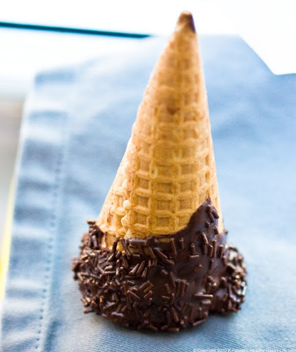 chocolate dipped ice cream cones with chocolate sprinkles dipped by ...