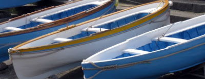 Blue and white boats in Capri Italy
