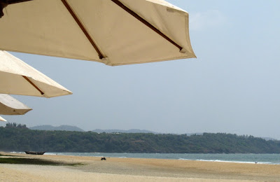Umbrellas on the beach in Goa at the Leela Kempinski Hotel
