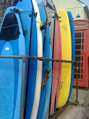 Surfboards leaning against a wall in Newquay, England