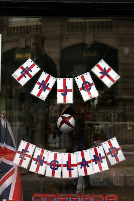England flags in a shop window during the World Cup