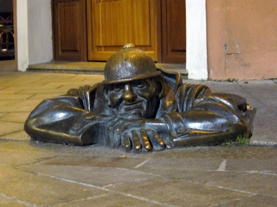 Sculpture of a man coming out of a manhole in Bratislava Slovakia
